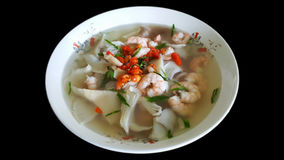 Tom yum goong, spicy shrimp soup, famous Thai food isolated on b Stock Photo