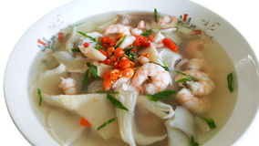 Tom yum goong, spicy shrimp soup, famous Thai food isolated on b Royalty Free Stock Photos