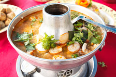 Tom Yum Goong, spicy soup with shrimp in a hot pot. Royalty Free Stock Image
