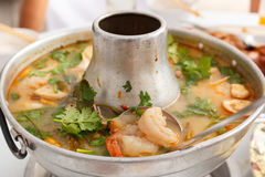 Tom Yum Goong, spicy soup with shrimp in a hot pot. Stock Images