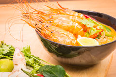 Tom Yum Goong, Thai hot spicy soup shrimp on Black Cup Royalty Free Stock Images