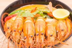 Tom Yum Goong, Thai hot spicy soup shrimp on Black Cup Stock Photography