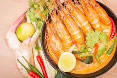 Tom Yum Goong, Thai hot spicy soup shrimp on Black Cup. With wooden table, Thailand Food Stock Photo