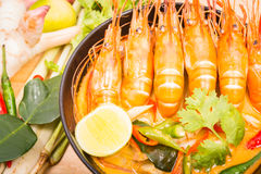 Tom Yum Goong, Thai hot spicy soup shrimp on Black Cup. With wooden table, Thailand Food Royalty Free Stock Photo