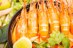 Tom Yum Goong, Thai hot spicy soup shrimp on Black Cup. With wooden table, Thailand Food Stock Image