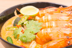 Tom Yum Goong, Thai hot spicy soup shrimp on Black Cup. With wooden table, Thailand Food Stock Photography