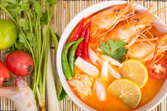 Tom Yum Goong, Thai hot spicy soup shrimp. On wooden background, Thailand Food Stock Photo