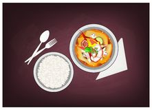Tom Yum Goong or Thai Spicy Sour Soup on Chalkboard. Thai Cuisine, Tom Yum Goong or Thai Spicy and Sour Soup with Shrimps on Chalkboard. One of The Most Famous Royalty Free Stock Photography