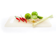 Tom Yum ingredient red chilli pepper, lime,Cymbopogon citratus. On white background Royalty Free Stock Images