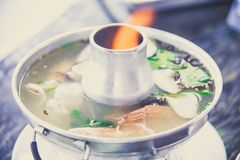 Tom Yum Koong has shimp, mushroom boil with Thai herb is the fam Stock Image