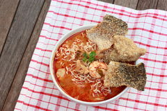 Tom Yum Kung noodle. Hot and spicy Thai dish Tom Yum Kung noodle served with fried salmon fish skin Stock Photography