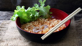 Tom Yum Kung Noodle. Tom Yum Kung.Thai soup, usually cooked with shrimp. Its hot and sour flavours. Instant noodles are a precooked and have dried noodle block Royalty Free Stock Images