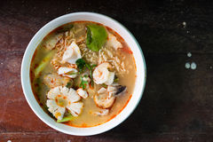 Tom Yum Kung with noodles and seafood Stock Photography