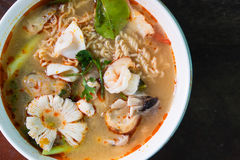 Tom Yum Kung with noodles and seafood Royalty Free Stock Image