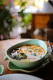 Tom Yum Kung. Rest in the street and enjoy a bowl of Tom Yum Kung in Chiang Mai, Thailand Stock Photo