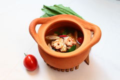 Tom Yum Kung (thai food) in clay pot Stock Image