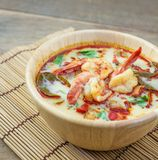 Tom yum kung on wood table. Spicy soup of thailand Royalty Free Stock Images