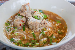 Tom yum noodles and soft pork ribs. Stock Images