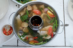 Tom Yum Pla. Thai fish Tom yum clear spicy hot & sour soup, Thai cuisine Royalty Free Stock Photo