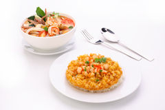 Tom Yum Soup, fried omelet topped on rice Royalty Free Stock Image
