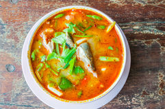 Tom yum soup. On grunge wooden table Stock Photo