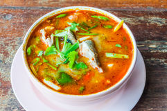 Tom yum soup. On grunge wooden table Royalty Free Stock Photography