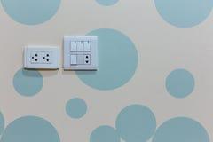 Toma de corriente y interruptor de la luz Fotos de archivo