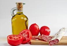 Tomaat, olie en salami Royalty-vrije Stock Fotografie