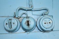 Tomada e interruptor velhos de parede Fotografia de Stock Royalty Free