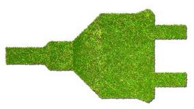 Tomada elétrica no conceito da energia do verde de grama Imagens de Stock Royalty Free