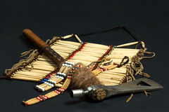 Tomahawk and Indian necklace royalty free stock images