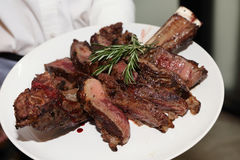 Tomahawk steak. Background of juicy tomahawk steak royalty free stock photo