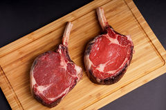Tomahawk Steak on wood board Stock Photography