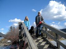 Tomando a criança e o cão para uma caminhada Imagens de Stock Royalty Free