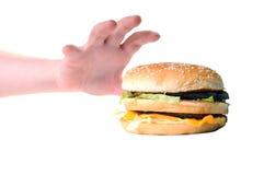 Tomando o hamburguer Imagens de Stock Royalty Free