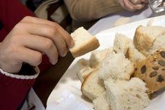 Tomando o pão Foto de Stock Royalty Free