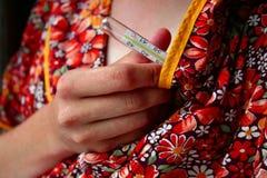 Tomando a temperatura Fotografia de Stock