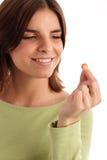Tomando um comprimido Foto de Stock