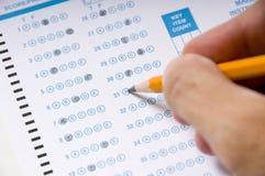 Tomando uma examinação ou um teste imagens de stock royalty free