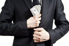 Tomar el dinero del soborno Imágenes de archivo libres de regalías