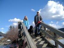 Tomar el niño y el perro para una caminata Imágenes de archivo libres de regalías