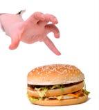 Tomar la hamburguesa Imágenes de archivo libres de regalías