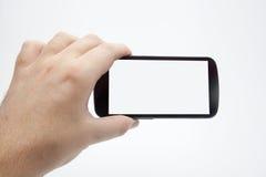 Tomar las fotos del smartphone Imagen de archivo libre de regalías