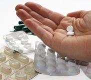 Tomar píldoras Imágenes de archivo libres de regalías