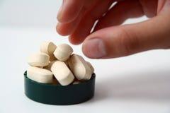 Tomar píldoras Foto de archivo libre de regalías