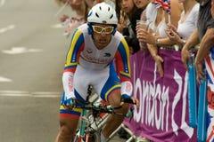 Tomas Aurelio Gil Martinez. The pain is written over the face of Venezuelan Cyclist Tomas Aurelio Gil Martinez, on the road in Surrey in the London 2012 Olympic Royalty Free Stock Photo
