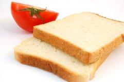 tomat för 2 rostat bröd Arkivfoto