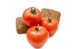 Tomat för tre red och fred av bröd Arkivfoton