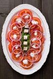 Tomat, Feta, lökar och Arugulasallad Arkivbilder