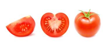 Tomat och en skiva av tomaten royaltyfri fotografi